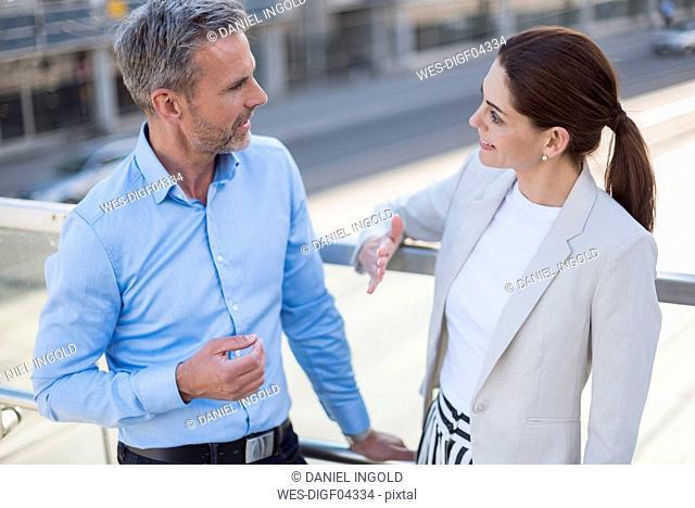 Businesswoman talking to business partner