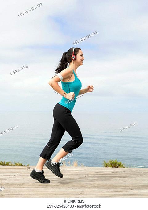 Beautiful young woman in outdoor doing yoga