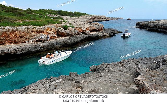 Touristic boats in Cala Estreta, a small bay in the municipality of Felanitx, Majorca island, Spain, Europe
