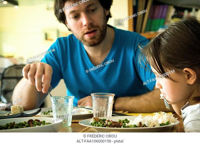 Little girl refusing to eat her dinner
