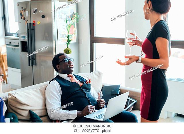 Businessman and businesswoman talking in loft office