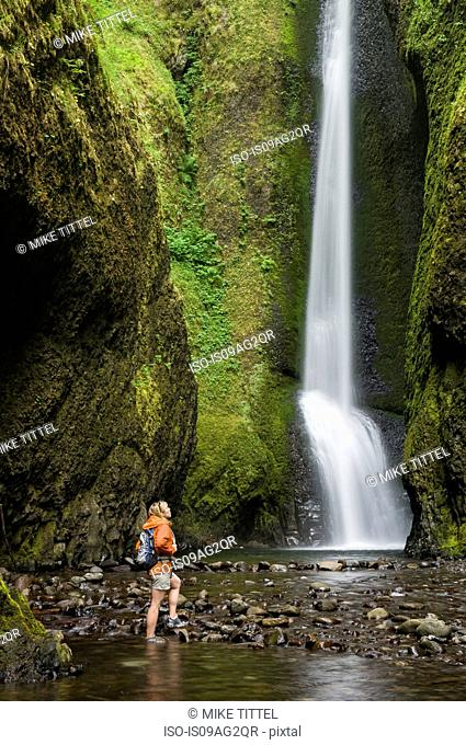 Woman Hiking at the base of Oneonta Falls, Columbia River Gorge, Oregon, USA
