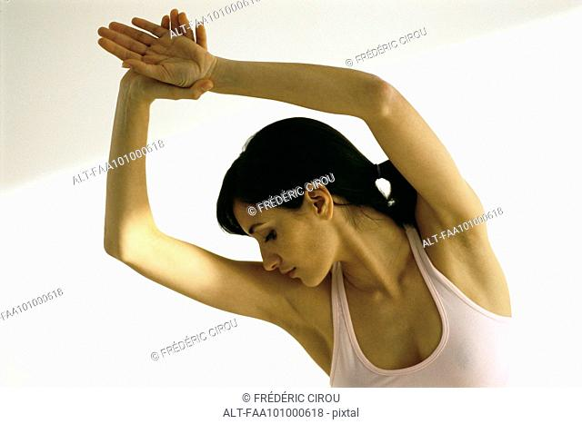 Woman stretching, arms in air