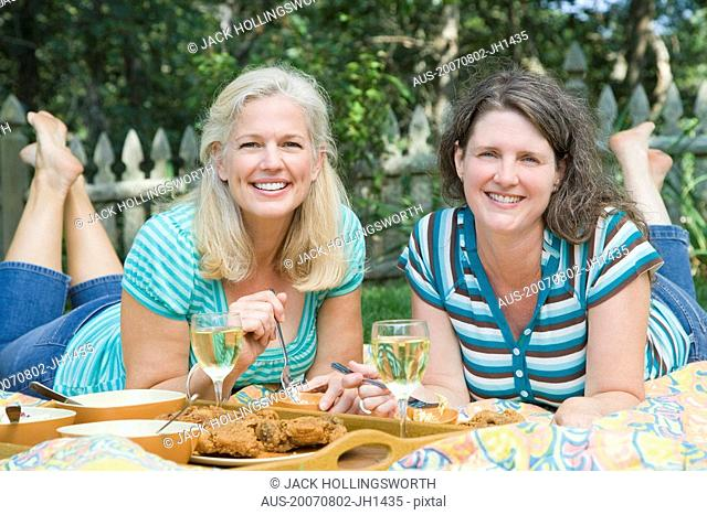 Portrait of two mature women having lunch