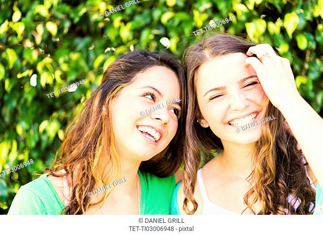Portrait of female friends (14-15)