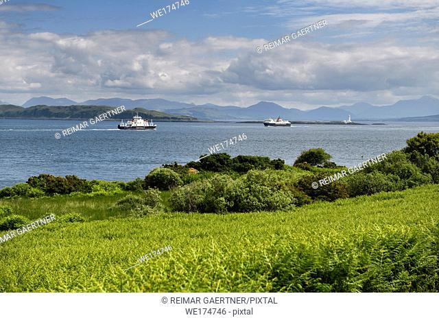 Sound of Mull Ferries at Loch Linnhe with Lismore Lighthouse and Ben Cruachan mountains from Duart Castle bracken Scotland UK