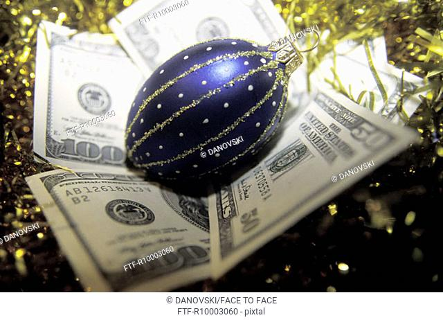 Dollar note with christmas ball