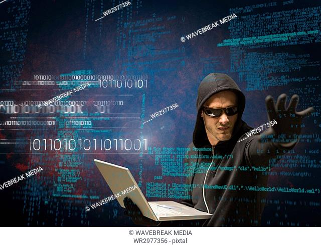 Hacker holding a laptop and extending his arm in front of 3D digital background