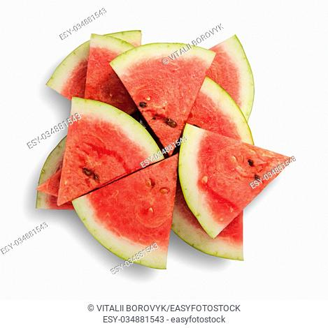 Slices of watermelon in a chaotic stack isolated on white background