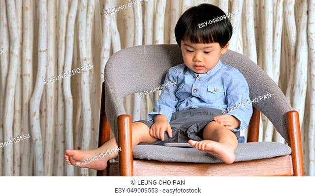 Baby boy watching on cellphone