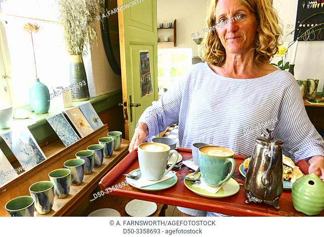 Bindslev, Denmark A customer holds a tray of coffee and cake at the Dorthe Hansen Keramik Cafe in the countryside