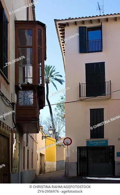 Two three story buildings and blue sky detail in Palma Old Town, Mallorca, Balearic islands, Spain