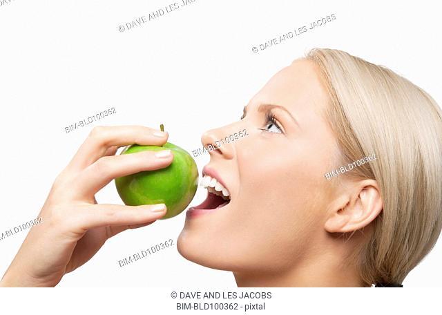Caucasian woman eating apple