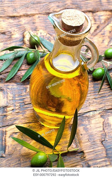 Tasting olive oil and freshly harvested olives