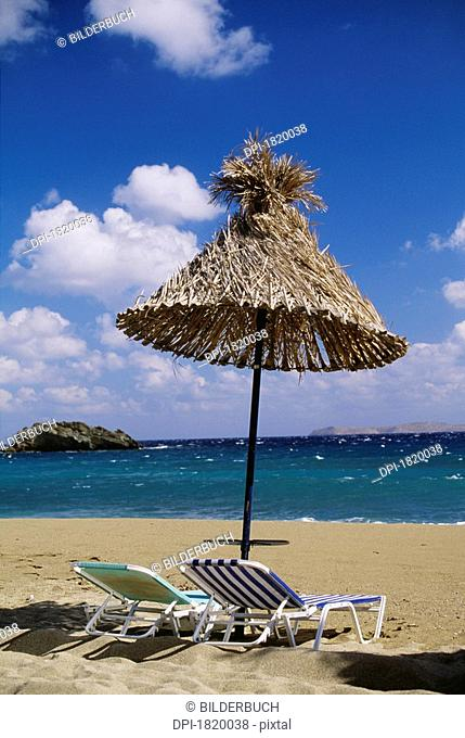 Beach chairs and umbrella on beach, Crete, Greece