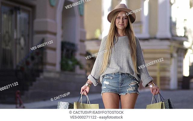 Shopaholic woman holding many shopping bags