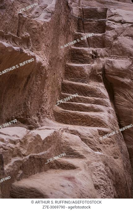 Steps carved into a rose-colored sandstone cliff. Petra Archaeological Park, Petra. UNESCO World Heritage Site, one of the new Seven Wonders of the World