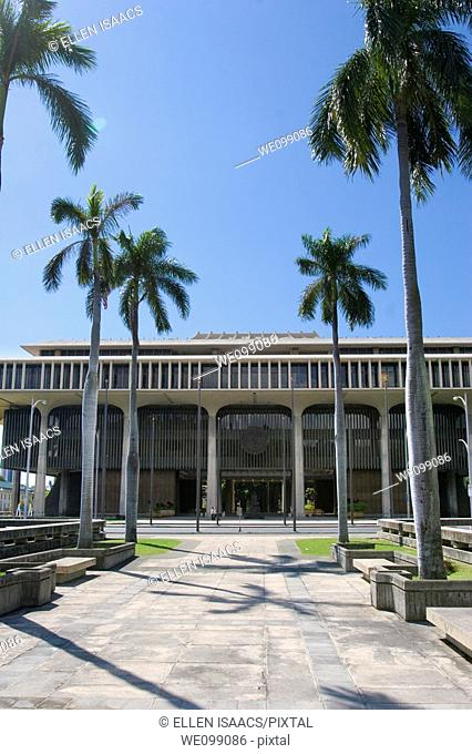 Palm trees leading to the front entrance of the Hawaii state capitol building or statehouse in Honolulu