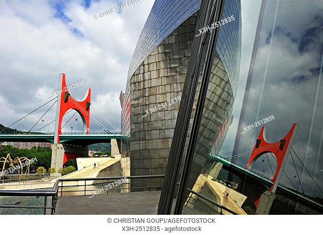 ''L'arc rouge'' The Red Arch by the French artist Daniel Buren on La Salve Bridge official name ''the Prince and Princess of Spain Bridge'' reflected on the...