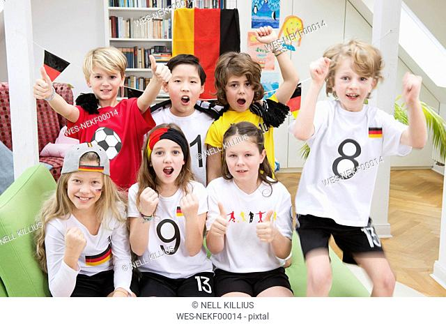 Group of kids watching soccer world championship, cheering