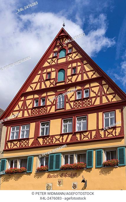 Half-timbered house in the historic city, Hotel Eisenhut, Rothenburg ob der Tauber, Bavaria, Germany, Europe