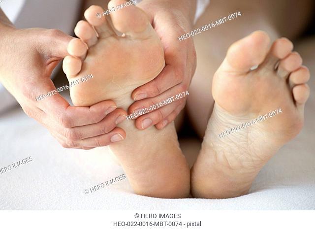 closeup of feet being massaged