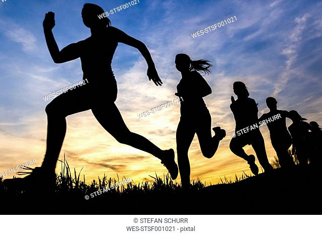 Silhouette of female jogger at sunset, sequence, phases