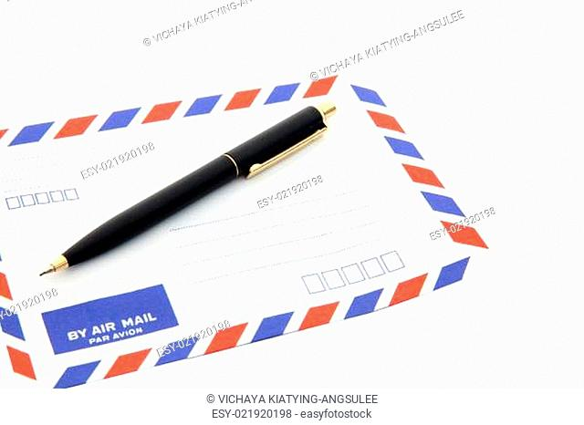 air mail envelope with pen isolated on white background
