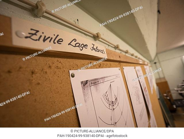 """18 April 2019, Rhineland-Palatinate, Alzey: """"""""Zivile Lage Inland"""""""" is written on a magazine board of the former government bunker of Rhineland-Palatinate"""
