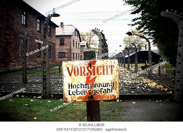 Oswiecim, Auschwitz, concentration camp, electric barbed wire fence, sign VORSICHT, Hochspannung, Lebensgefahr
