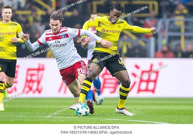 Dortmund's Manuel Akanji(R) and Hamburg's Albin Ekdal fight for the ball in Dortmund, Germany, 10 February 2018. Photo: Guido Kirchner/dpa