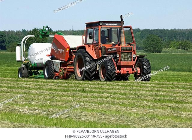 Volvo tractor pulling round baler and mechanical bale-wrapper, plastic wrapping round silage bale, Sweden