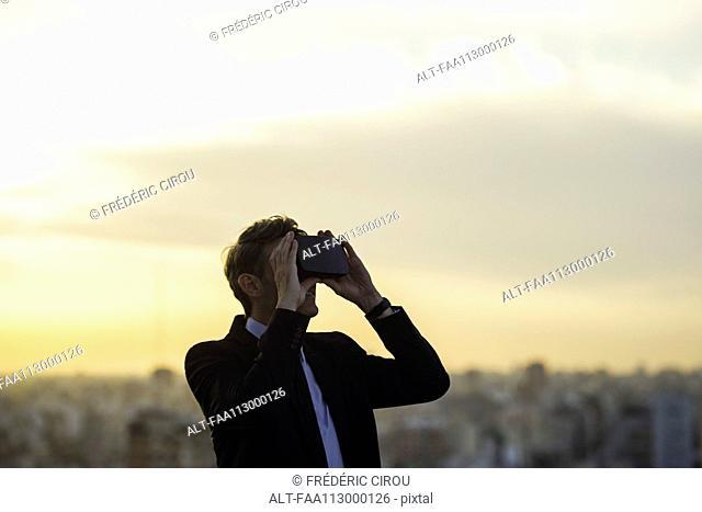 Man using virtual reality headset outdoors