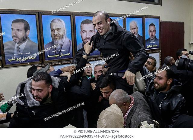 28 February 2019, Palestinian Territories, Gaza City: Relatives and supporters greet a member of the Palestinian Islamist Hamas movement, who was held in Egypt
