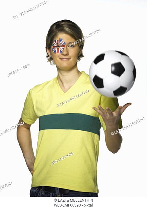 Australian female football fan holding football