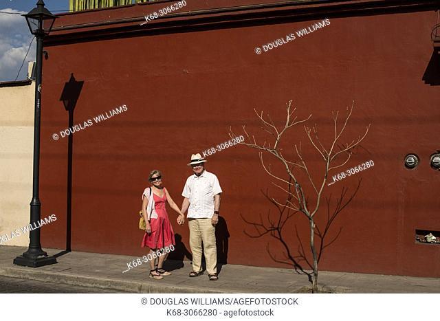 couple, 66, on a street in Oaxaca city, Oaxaca, Mexico