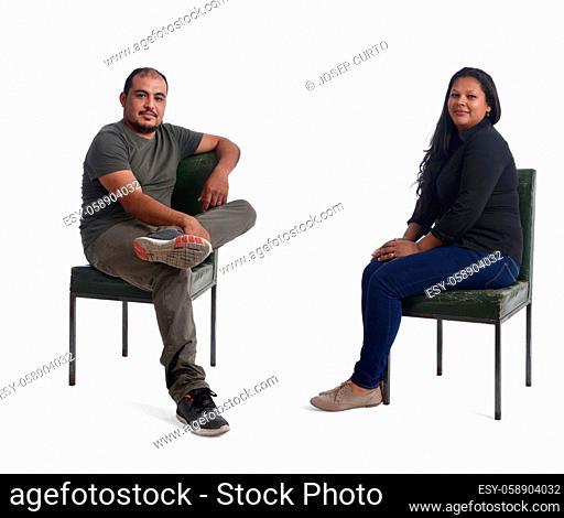 latin couple sitting on white background