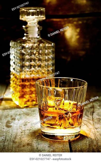 Glass and bottle of hard liquor
