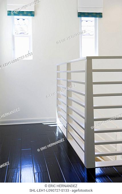 White metal railing along staircase