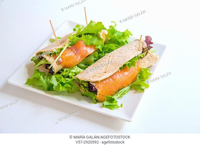 Smoked salmon with lettuce in a rolled bread