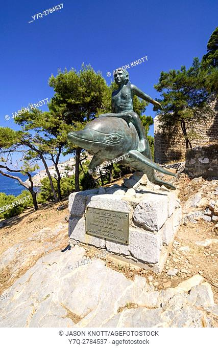 Bronze Boy on a Dolphin statue, an artwork based on the film of the same name, filmed here in 1957, Hydra Island, Greece