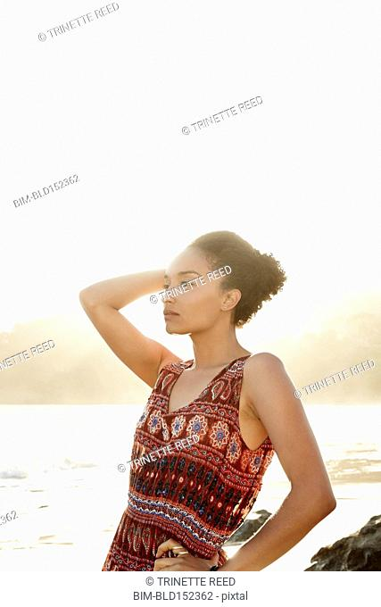 Mixed race woman posing on beach