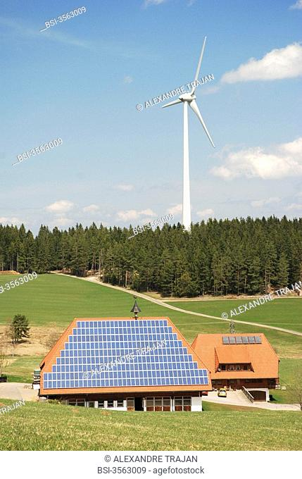 In Black Forest Germany farm equipped of solar panels near a wind power generator