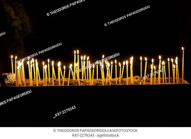 Candles in the cave church Panagia Kefalariotisa. Argolis, Peloponnese, Greece