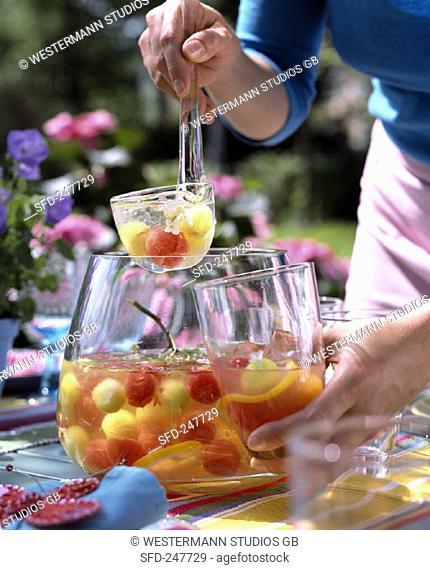 Melon and elderflower punch on table in garden