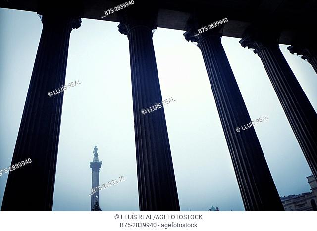 Nelson's Column seen through the columns of the National Gallery, Trafalgar Square, London, England
