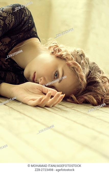 Portrait of a woman laying on the floor