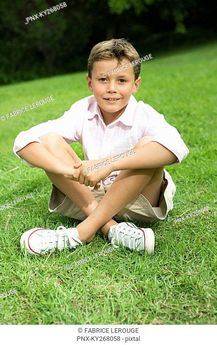 Boy sitting in a park