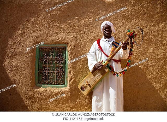 Musician in the village of Khamlia, ancient slave from Sudan, Merzouga, Sahara Desert, Morocco