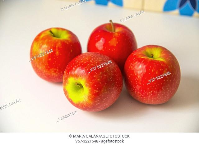 Four red apples. Still life